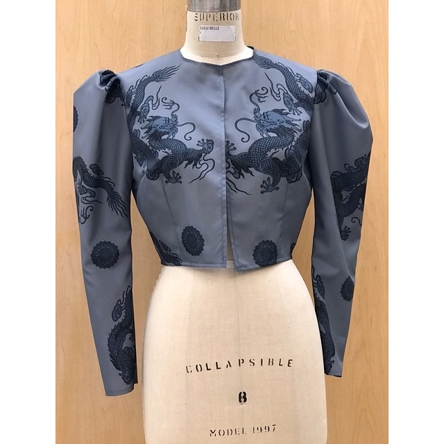 Shows front view of the final garment with dragons on the left and right side of the bodice front facing each other.