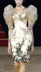 A model wearing a princess sleeved dress with internal armature by Alexander McQueen from 2007