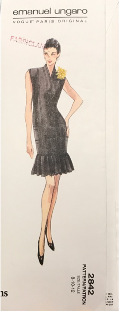 The drawing of the dress from the pattern. It is sleeveless with a kimono collar and a sharply creased flounce that hits mid thigh.